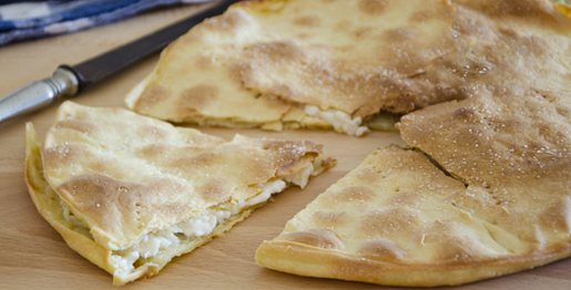 learn more bout the focaccia di recco genova -italian street food